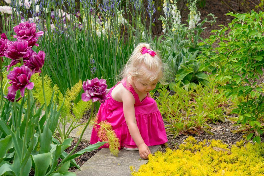 Girl exploring a sensory garden in the spring